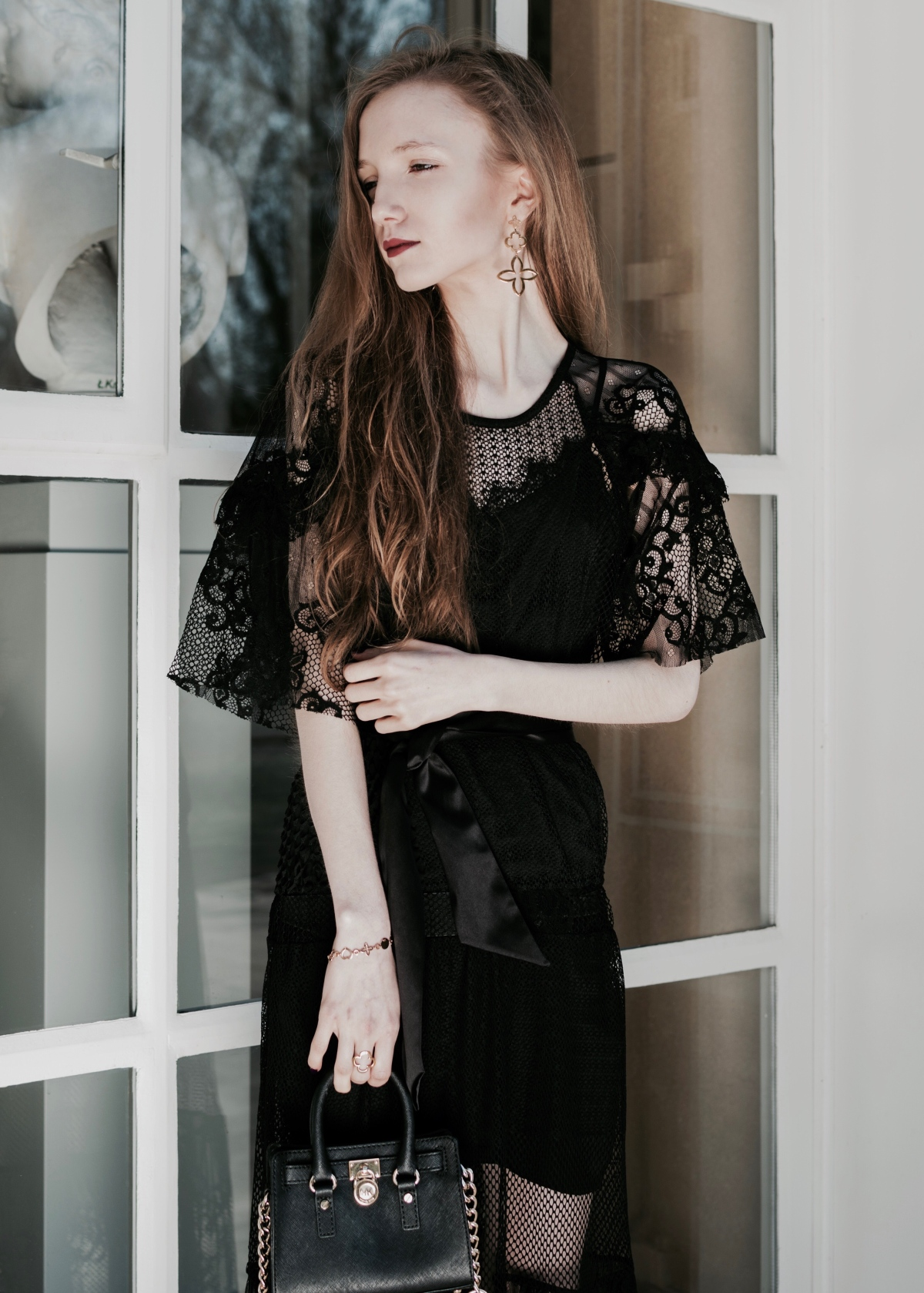 Long black lace dress in Łazienki Palace Gardens